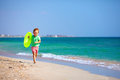 Happy boy running the beach expressing delight surf Royalty Free Stock Images