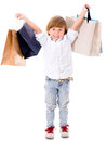 Happy boy shopping with bags isolated over a white background Royalty Free Stock Image