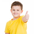 Happy boy showing thumbs up gesture isoated on white Stock Images