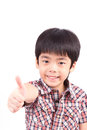 Happy boy showing thumbs up gesture isolated on white background Stock Photos