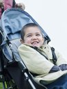 Happy Boy Sitting On Pram Royalty Free Stock Photo