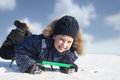Happy boy on sled outdoors Royalty Free Stock Photo