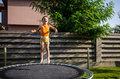 Happy boy on a trampoline Royalty Free Stock Photo