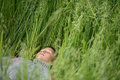 Happy boy young man on a green grain field Royalty Free Stock Photo