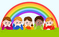 Happy boys and girls lying on a green grass with rainbow. Royalty Free Stock Photo