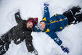 Happy boys in snow play and smile sunny day Royalty Free Stock Photo
