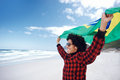 Happy brasil supporter portrait of young brazilian man with flag supporting soccer team for world cup Stock Photography