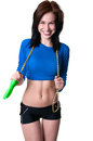Happy brawny girl with skipping rope attractive young woman holding a over her shoulders looking at camera and smiling toothy shy Royalty Free Stock Photo