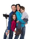 Happy Brazilian family mother and father taking selfie photo with little son and daughter having fun Royalty Free Stock Photo