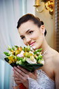 Happy bride with a bouquet of flowers Royalty Free Stock Photos