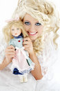 Happy bride with doll Stock Photos