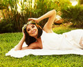 Happy bride on the grass Royalty Free Stock Photos