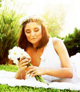 Happy bride on the grass Royalty Free Stock Image