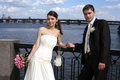 Happy bride and groom on background of dnipro river Stock Photo