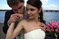 Happy bride and groom on background of dnipro river Stock Image