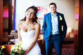 Happy bride and groom in a bright room Royalty Free Stock Images