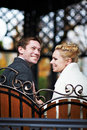 Happy bride and groom on decorative bench Stock Photography