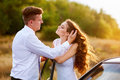 Happy bride and groom hugging near car Royalty Free Stock Photo