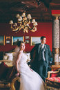 Happy bride and groom in luxury chairs in chic interiors Royalty Free Stock Photo