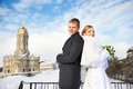 Happy bride and groom near ancient temple on wedding day sky background Stock Photo