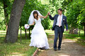 Happy bride groom shady alley wedding walk Stock Photo