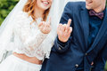 Happy bride and groom show his finger with rings Royalty Free Stock Photo