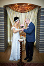 Happy bride and groom on solemn registration Stock Photography