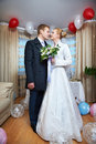 Happy bride and groom together in holiday interior Stock Images
