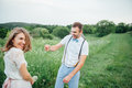 Happy Bride and groom walking on the green grass Royalty Free Stock Photo