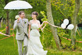 Happy bride and groom walking together in a park Royalty Free Stock Photo