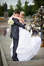Happy bride and groom at wedding walk on bridge Royalty Free Stock Image