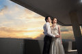 Happy bride and groom at the wedding walk in front of sunset in city Stock Image