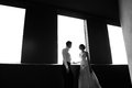 Happy bride and groom at the wedding walk in front window Royalty Free Stock Images