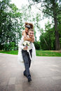 Happy bride and groom at wedding walk in the park Royalty Free Stock Photos