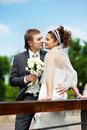 Happy bride and groom at wedding walk in the park Royalty Free Stock Image