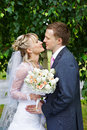 Happy bride and groom in wedding walk in park Stock Photography