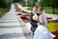 Happy bride and groom at wedding walk in park Royalty Free Stock Photo