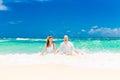 Happy bride having fun on a tropical beach wedding and honeymoo groom honeymoon the island Stock Photo