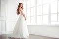 Happy bride indoors