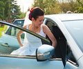 Happy bride leaving for party by car Royalty Free Stock Images