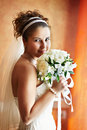 Happy bride near window with flowers Royalty Free Stock Photography