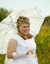 Happy bride with a parasol Royalty Free Stock Photos