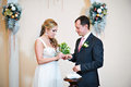 Happy bride wears wedding ring her groom solemn registration of marriage Stock Photography