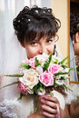 Happy bride with wedding bouquet indoors closeup Stock Photography