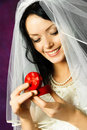 Happy bride with a wedding ring Stock Photos