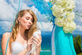 The happy bride with white doves on a tropical beach under palm Royalty Free Stock Photo