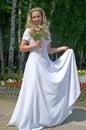 Happy bride in a white wedding dress Stock Photo
