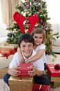 Happy brother and sister celebrating Christmas Royalty Free Stock Image