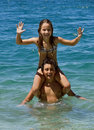 Happy brother and sister in fun on sea Royalty Free Stock Photography