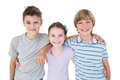Happy brothers and sister standing arms around Royalty Free Stock Photo